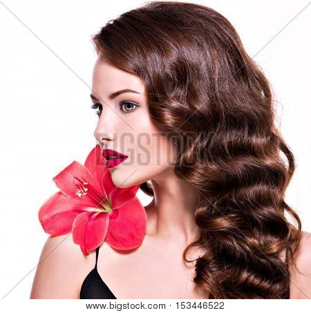 Closeup portrait of young beautiful woman with  flower near the face  - isolated on white background