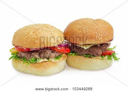 Hamburger and cheeseburger with beef patty cheese vegetables and condiments on a light background