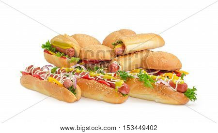 Pile of different hamburgers with beef patty and different hot dog with frankfurter and vegetables on a light background