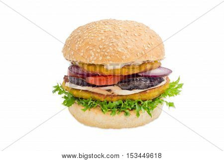 Vegetarian burger with filling of two lentil patties lettuce tomato onion eggplant mushrooms and condiments on a light background