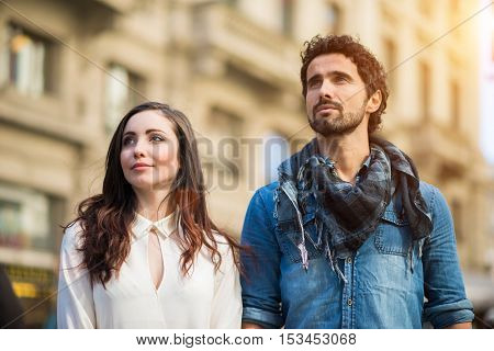 Couple walking together in a city