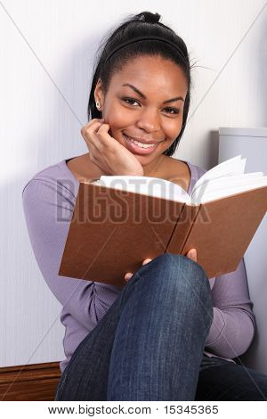 Beautiful Happy African Girl Reading A Book