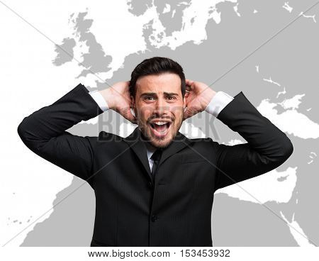 Desperate businessman in front of a world map