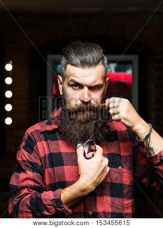 Bearded Man With Scissors