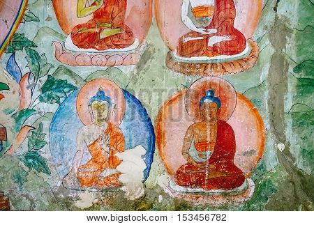 Thiksey village in Ladakh, India - AUGUST 20: Buddha Incarnation elements of wall painting in Thiksey Monastery on August 20, 2016  in Thiksey village in Ladakh, India.
