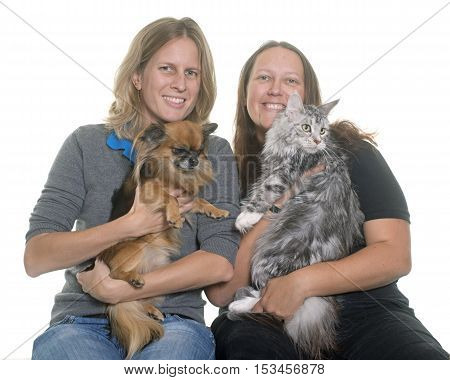 women and pet in front of white background