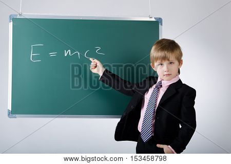 photo of little funny boy with blackboard
