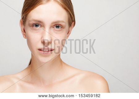 Beautiful Face of Young Woman with Clean Fresh Skin close up isolated on white. Beauty Portrait. Beautiful Spa Woman Smiling. Perfect Fresh Skin. Youth and Skin Care Concept. dark circles under eyes