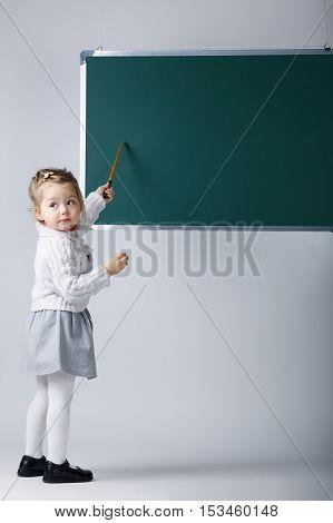 photo of cute little girl with blackboard