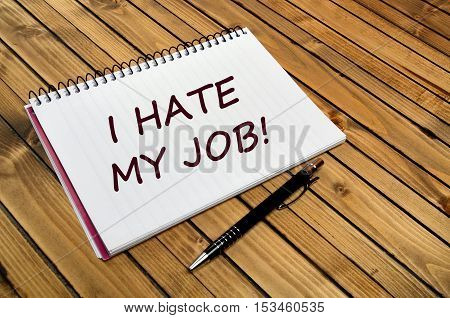 I hate my job words on notebook