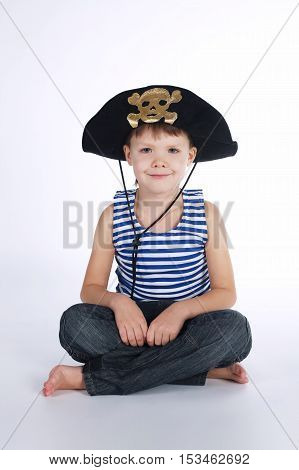 little boy in pirate costume on white background