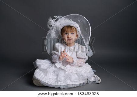 photo of little beautiful girl in wedding dress