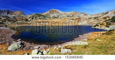 Autumn landscape in Natural Park Retezat, Bucura Lake, Romania, Europe