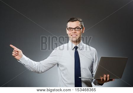Young businessman with laptop in business concept