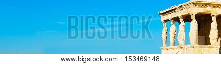 Banner background with Acropolis, Erechtheum Temple in Athens, Greece and blue sky