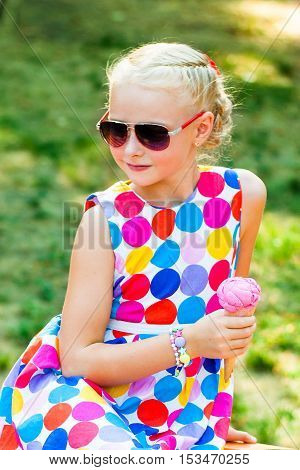 Girl with ice cream on a summer nature close-up
