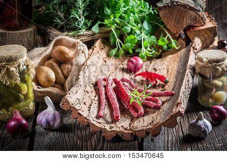 Closeup Of Fresh Kabanos Sausages On Bark
