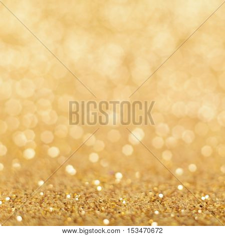 Christmas background. Shiny golden abstract background. Glitter background