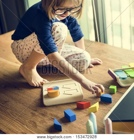 Little Girl Playing Toys Concept
