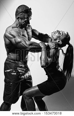 Muscular Man Strangling A Beautiful Woman