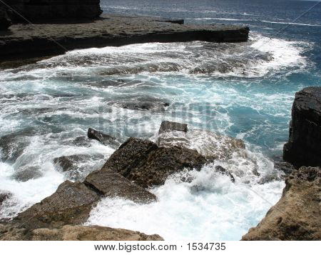 Surf Crashing On Rocks