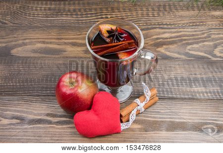 Mulled Wine, Serdtseb Red Apple And Cinnamon Sticks On Wooden Background. Autumn