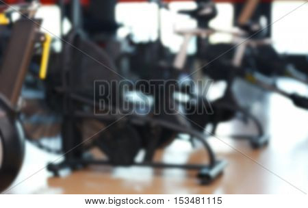 Fitness equipment in modern gym, blurred view