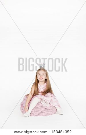 Vertical full body portrait of cute little girl child with blond hair and pink dress isolated on white background with copy space above head