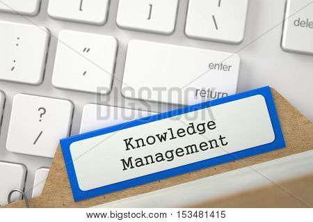 Orange File Card with Inscription Knowledge Management Lays on White PC Keyboard. Closeup View. Blurred Illustration. 3D Rendering.