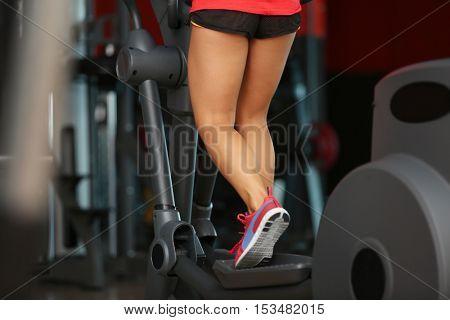 Woman training in modern gym