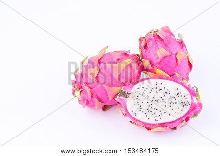 fresh  raw organic dragon fruit (dragonfruit) or pitaya on white background healthy fruit food isolated
