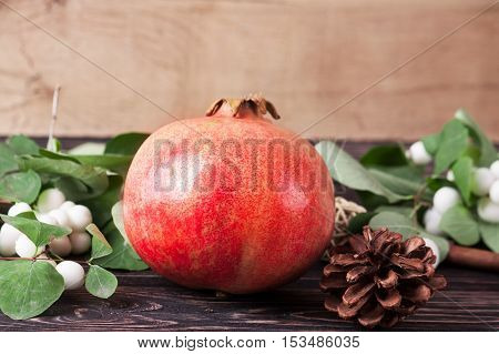 Ripe fresh pomegranate on wood board. Food background
