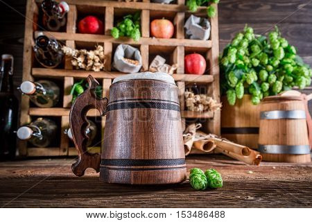 Various Cider Beer And Ingredients In Wooden Box