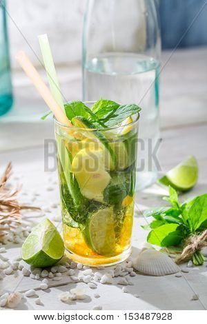 Cold Summer Drink With Lemon, Lime And Sugar