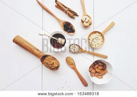 Cashew nuts, raisins, oats, honey, almonds, cinnamon, and seeds
