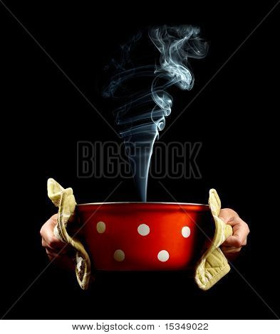 Pan with smoke in hands