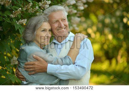 Portrait of a senior couple resting at autumn park