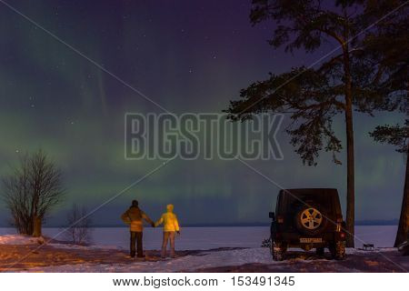 Leningrad Oblast, Russia, February 16, 2016. Jeep Wrangler on the shore of Lake Ladoga, the Jeep Wrangler is a compact four wheel drive off road and sport utility vehicle