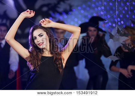 Young woman dressed as vampire at Halloween party
