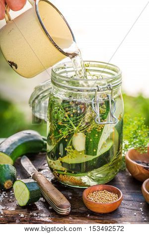 Pouring Water Into Jar With Zucchini And Spices