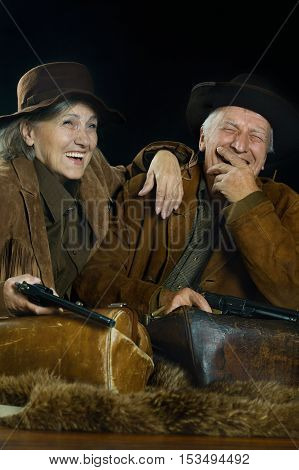 Two smiling hunters in western clothes, closeup