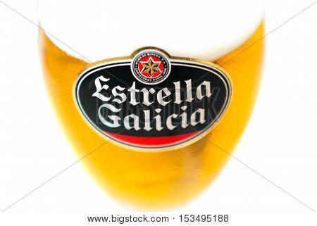 A Coruna Spain - May 28 2016: Estrella Galicia pale lager draught or draft beer isolated on white background. Estrella Galicia has been produced by Hijos de Rivera Brewery in La CorunaSpain since 1906.