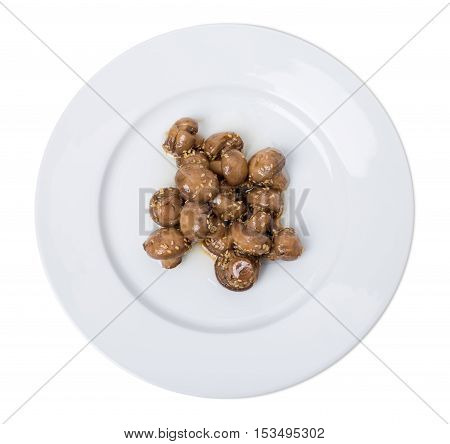 Roasted champignons with sesame in asian style. Isolated on a white background.