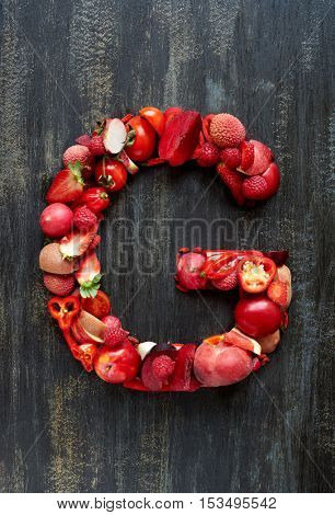 Red color collection of raw produce shaped to food letters of alphabet, poster design element