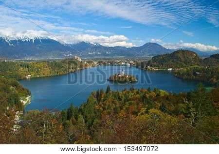 View of the castle and of the Church of the Assumption in the island of the Lake of Bled (Blejsko jezero) with the Karawanks Alps in the background, Slovenia