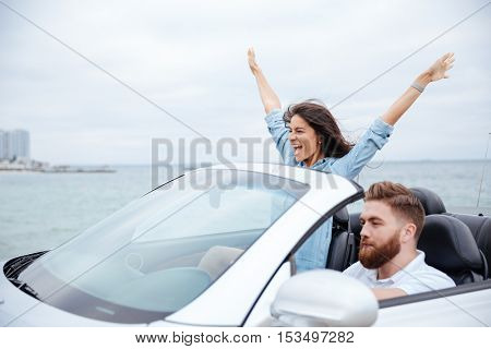 Young beautiful couple on road trip drive in car together
