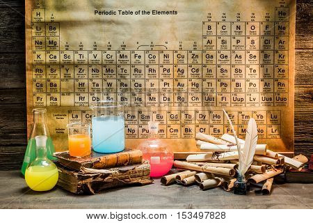 Chemical laboratory with tubes with reagents on old wooden table