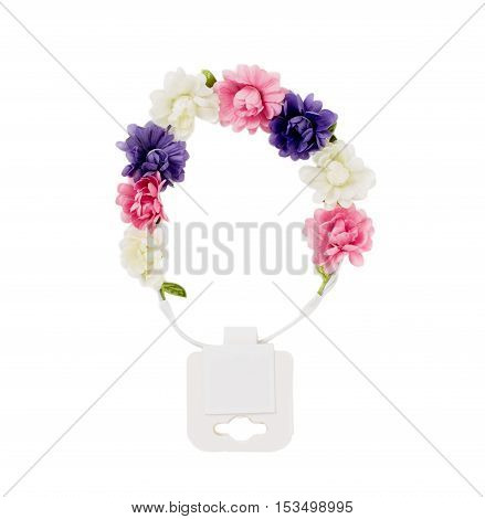 Hair band with artificial flowers and blank label. Isolated on a white background.