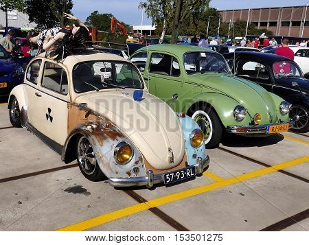 Amsterdam The Netherlands - September 10 2016: Two classic Volkswagens on display during Cars & Coffee XXL show. Non-ticketed public event held in the streets of the city with people carspotting.
