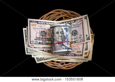Basket with us dollar isolated on black